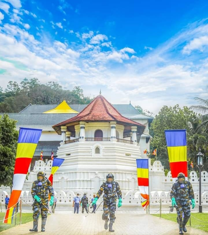 "Sri Lanka Air Force conducting fumigation in the famous "" Temple of the Tooth Relic""- www.healthreviewglobal.com"